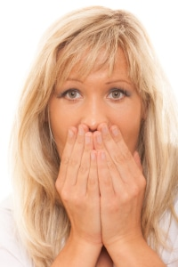 woman looking for bad breath cures